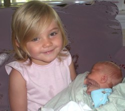Big sister holding him for the first time