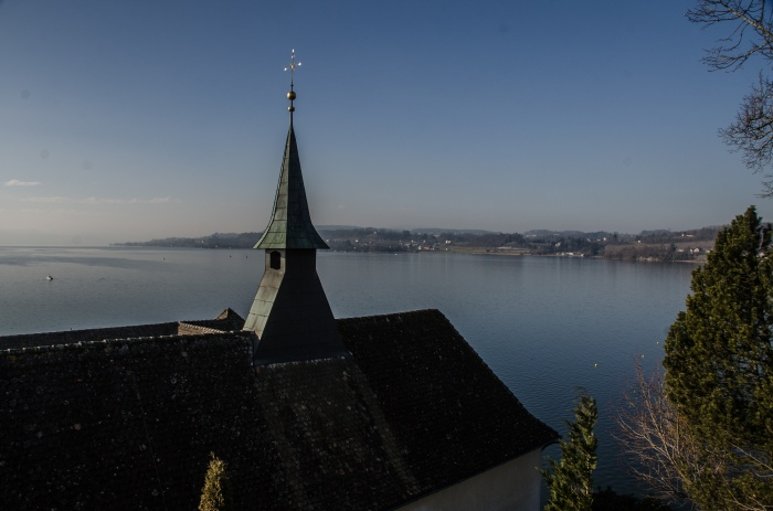 church spire over lake