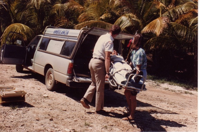 J and Jane loading patient into ambulance