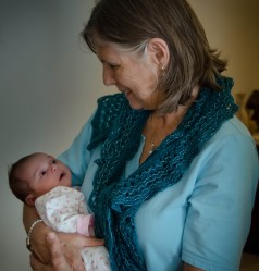 Grammi holding Elysse at 6 weeks