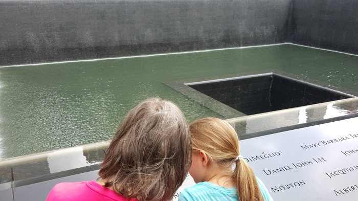 With granddaughter at WTC memorial reflection pond